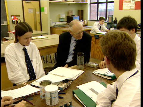 sir ron dearing returns to school england south yorkshire doncaster doncaster grammar school close shot blackboard being written on