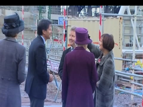 sir sebastian coe and sports minister tessa jowell talk with queen elizabeth ii during visit to london 2012 olympic park construction site london 3... - erektion stock-videos und b-roll-filmmaterial