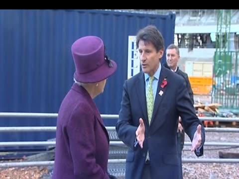 sir sebastian coe talks with queen elizabeth ii during visit to london 2012 olympic park construction site london 3 november 2009 - erektion stock-videos und b-roll-filmmaterial
