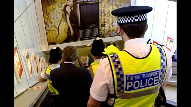 sir stephen richards found not guilty of exposing himself int back view british transport police on down escalator british transport police... - 無罪点の映像素材/bロール