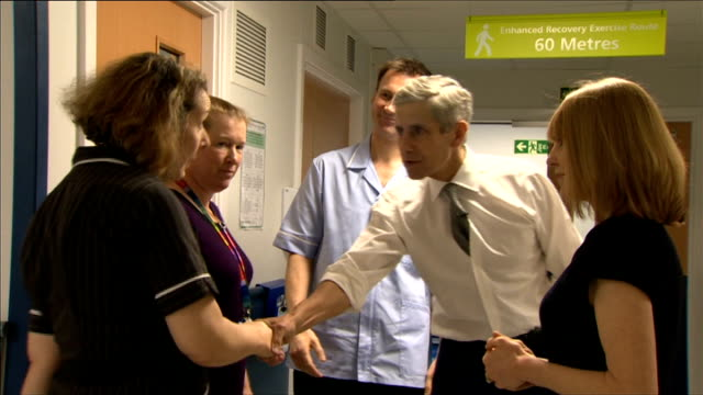 sir stuart rose to advise government on how to turn around failing hospitals; england: essex: basildon: int jeremy hunt mp and stuart rose along in... - basildon stock-videos und b-roll-filmmaterial