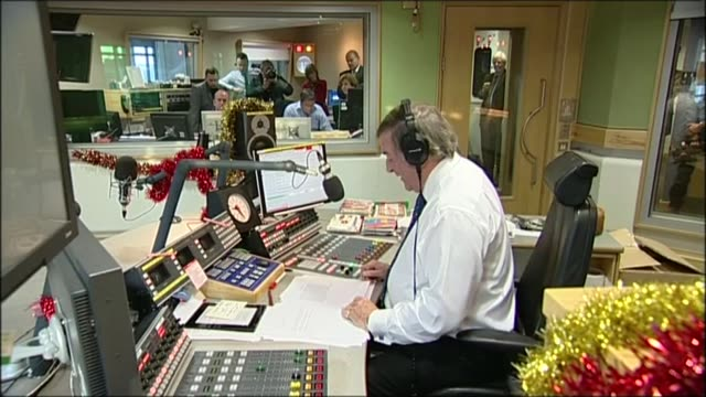 sir terry wogan dies from cancer aged 77; lib / int terry wogan in studio reading 'goodbye' statement to radio 2 listeners on air sot - terry wogan stock-videos und b-roll-filmmaterial
