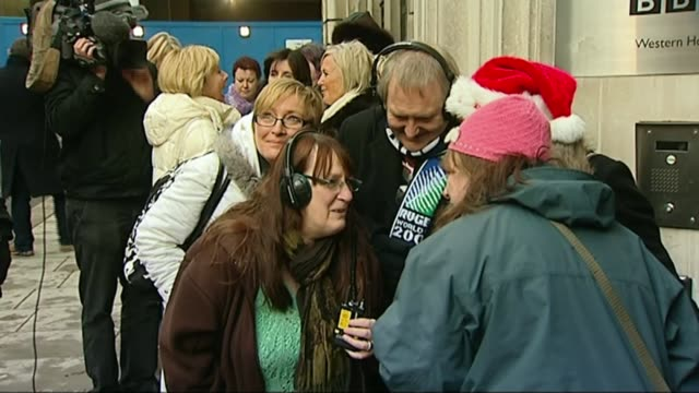 sir terry wogan dies from cancer aged 77; t18120914 / fans of wogan listening to last show on radios outside on last day at radio 2 sot radio in hand - terry wogan stock videos & royalty-free footage