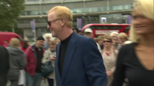 celebrity arrivals and interviews chris evans interview sot / alan yentob arrival / alesha dixon interview sot - terry wogan stock-videos und b-roll-filmmaterial