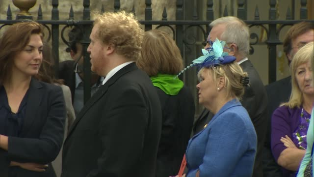 sir terry wogan memorial service held at westminster abbey; ext various shots of people waiting outside westminster abbey dermot o'leary along - terry wogan stock-videos und b-roll-filmmaterial