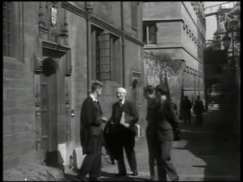 sir william h beveridge walking w/ british college students on university street ms beveridge parting from students entering building cu door plaque... - postwar stock videos and b-roll footage