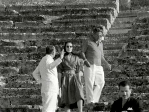 Sir Winston and Lady Churchill on holiday guests of Aristotle Onassis GREECE Athens MS Sir Winston Lady Churchill seated in Epidaurus ancient theatre...