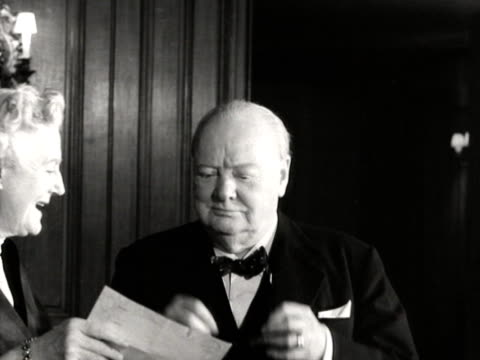 sir winston churchill and lady churchill read through telegrams to celebrate his 80th birthday - winston churchill prime minister stock videos and b-roll footage