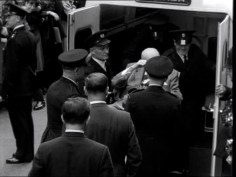 england london ext various of winston churchill smoking cigar as carried in chair from hospital to ambulance ambulance along past large crowds gvs... - cigar stock videos & royalty-free footage