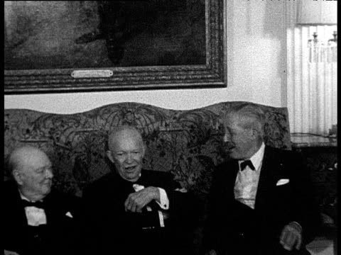vídeos de stock, filmes e b-roll de sir winston churchill president dwight d eisenhower and prime minister harold macmillan sit on sofa as other political figures file in behind for... - gravata borboleta