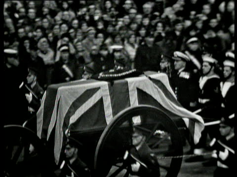 sir winston churchill's coffin draped in union jack flag is pushed along by navy officers during state funeral crowds in background london 30 jan 65 - winston churchill prime minister stock videos and b-roll footage