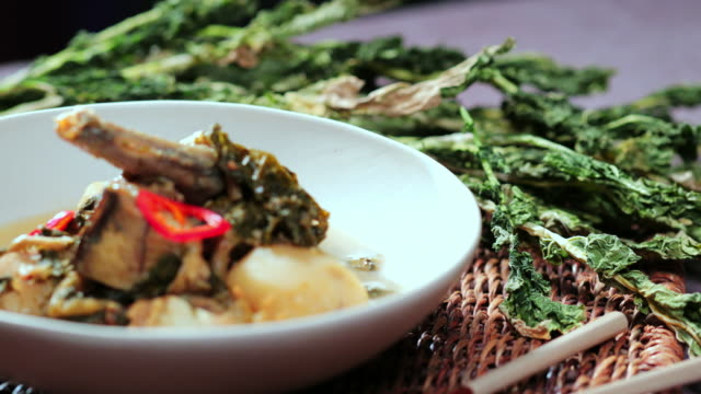 'siraegi' (dried radish leaves) and 'siraegi kodari jjim' (korean braised pollack with dried radish leaves) - pollock fish stock videos & royalty-free footage