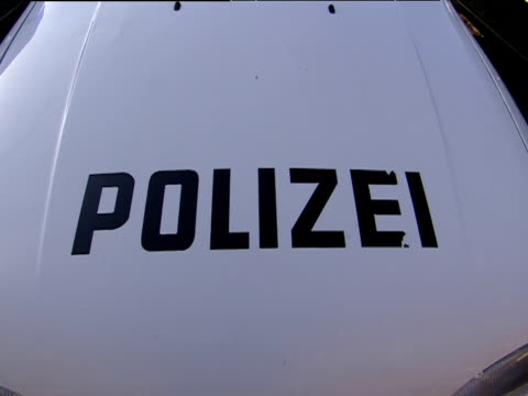 stockvideo's en b-roll-footage met siren lights and bonnet of german polizei car hamburg - polizei