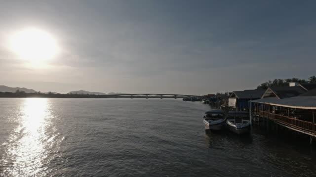 siri lanta bridge and saladan stilt houses over andaman sea at sunrise - ross sea stock videos & royalty-free footage