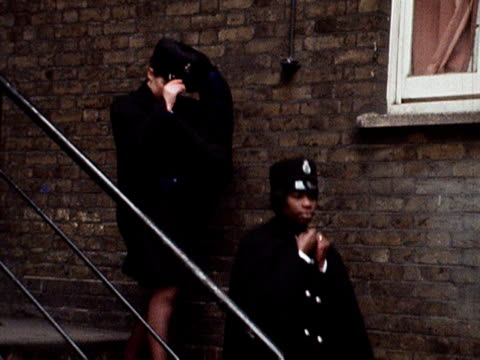 Sislin Allen the first black policewoman leaves a police station with a colleague 1968