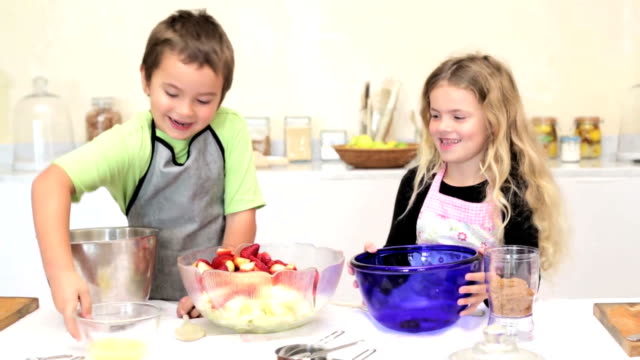 Sister and Brother baking together