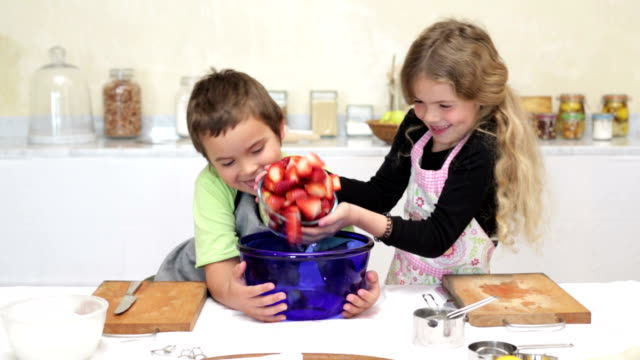 sister and brother baking together - mixing bowl stock videos and b-roll footage
