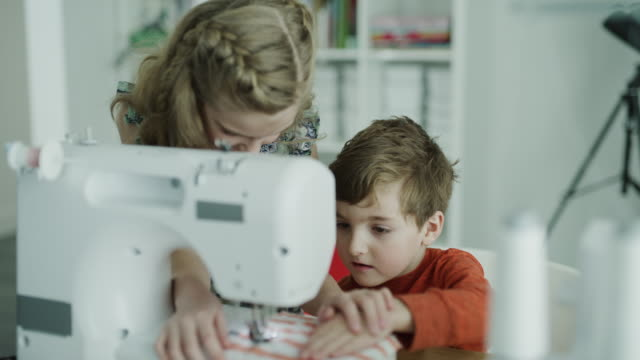 sister teaching brother to use sewing machine / lehi, utah, united states - lehi stock videos & royalty-free footage
