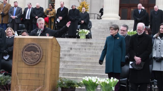 sister theresa bangert delivers the innvocation at the inauguration of laura kelly as the 48th governor of kansas - 長点の映像素材/bロール