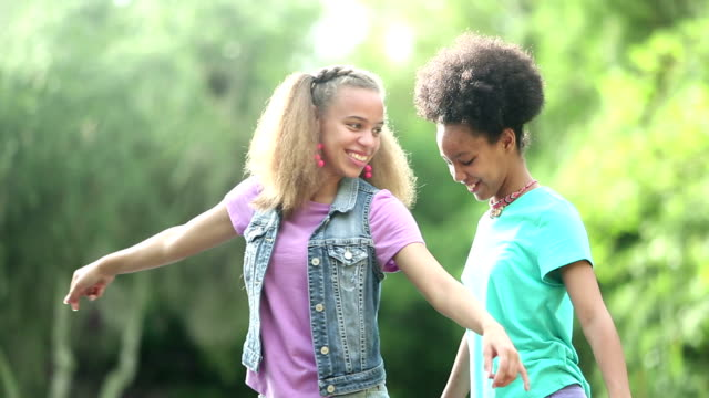 sisters at park, walking, balancing, arms outstretched - 12 13 years stock videos & royalty-free footage