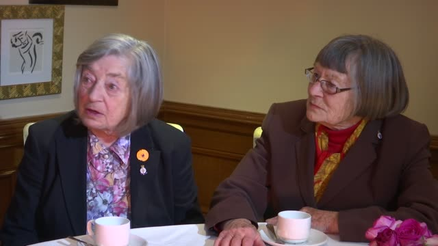 vídeos y material grabado en eventos de stock de sisters attend reunion at spy headquarters in london; england: london: int jean argles and patricia davies sitting chatting with reporter at table... - crucigrama