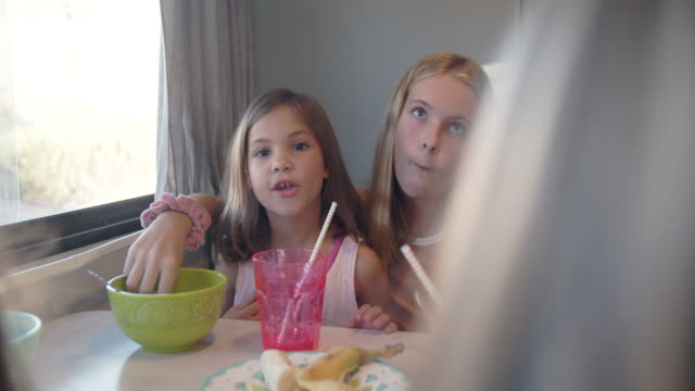 cu sisters eating breakfast together - caucasian ethnicity stock videos & royalty-free footage