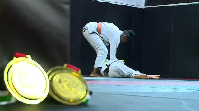 Sisters from Beckenham win gold in the World Youth JiuJitsu championships ENGLAND London INT Nia and Zuri Blackman practicing JiuJitsu holding medals