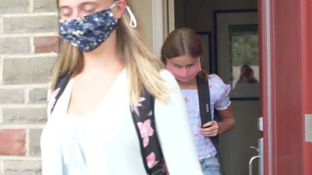 sisters getting ready for school wearing reusable face masks - first day of school stock videos & royalty-free footage