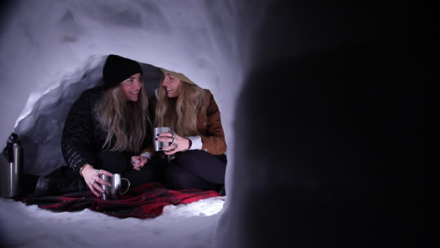 sisters hanging out in igloo at night on blanket - igloo stock videos & royalty-free footage