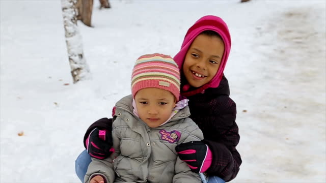 sisters having fun on winter vacations,enjoying on the slide - sliding stock videos & royalty-free footage