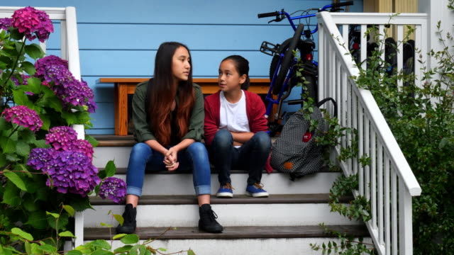 MS Sisters in discussion on front steps of home waiting for ride to school