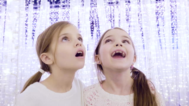 sisters in fantasy lights at christmas - sister stock videos & royalty-free footage