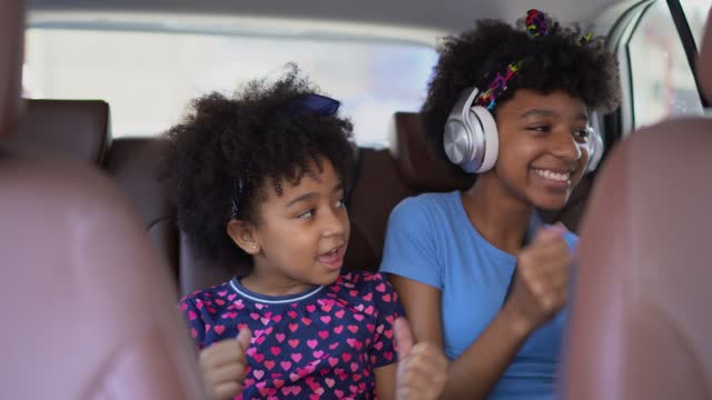 sisters in the backseat of car singing - passenger seat stock videos & royalty-free footage
