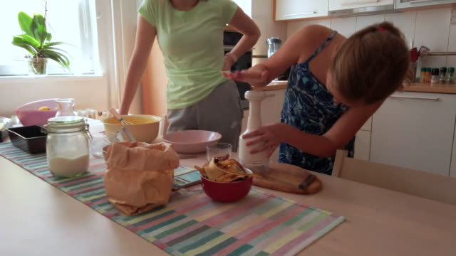 sisters making banana bread in kitchen - sister stock videos & royalty-free footage