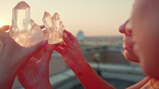 sisters meditating with healing crystals. rooftop view - new age stock videos & royalty-free footage