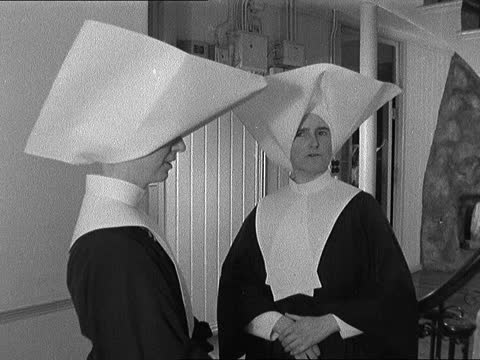 sisters of charity of st. vincent de paul change habit; england: london: mill hill: st vincent's convent: int sister wearing new habit down stairs,... - convent stock videos & royalty-free footage
