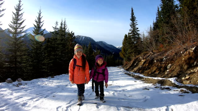 sisters on a winter hike - camping stock videos & royalty-free footage