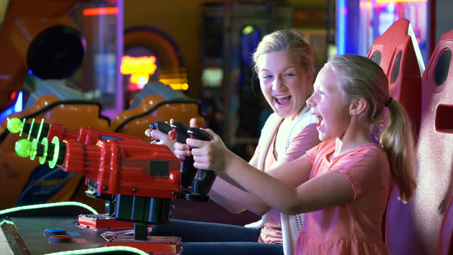 sisters playing amusement arcade game - 14 15 years stock videos & royalty-free footage