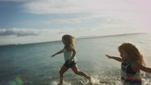 sisters playing and running on the beach in maui, hawaii. - pacific islander family stock videos & royalty-free footage