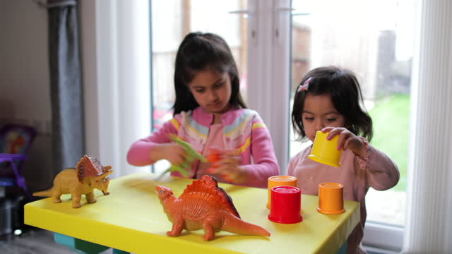 sisters playing with dinosaur toys - reptile stock videos & royalty-free footage