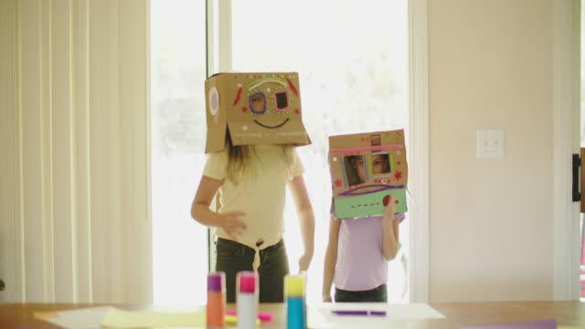 vídeos de stock e filmes b-roll de sisters pretending to be robots at home - irmãos
