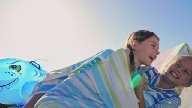 stockvideo's en b-roll-footage met sisters sitting - in een handdoek gewikkeld