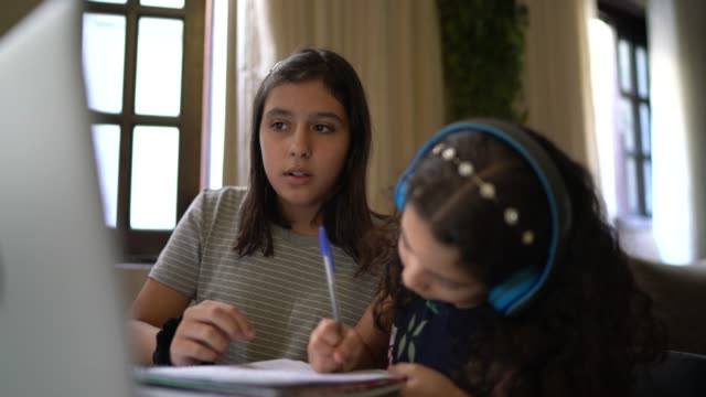 sisters studying together using laptop at home - sister stock videos & royalty-free footage