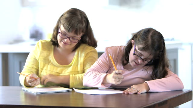 sisters with down syndrome doing homework - genetic mutation stock videos & royalty-free footage