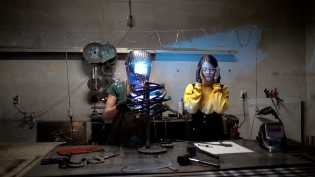 sisters working together - welder stock videos & royalty-free footage
