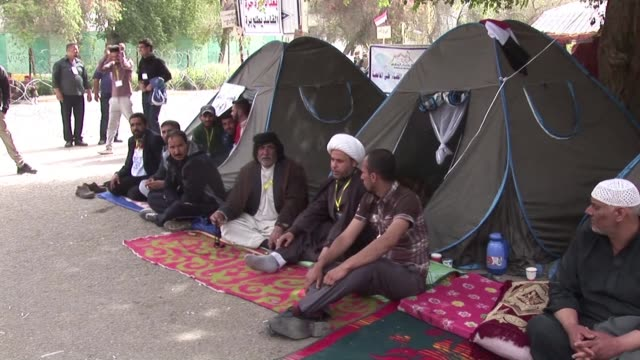 a sit in for reform by supporters of iraqi shiite cleric moqtada al sadr entered a fourth day on monday at the main gates of baghdads green zone... - compounding stock videos and b-roll footage