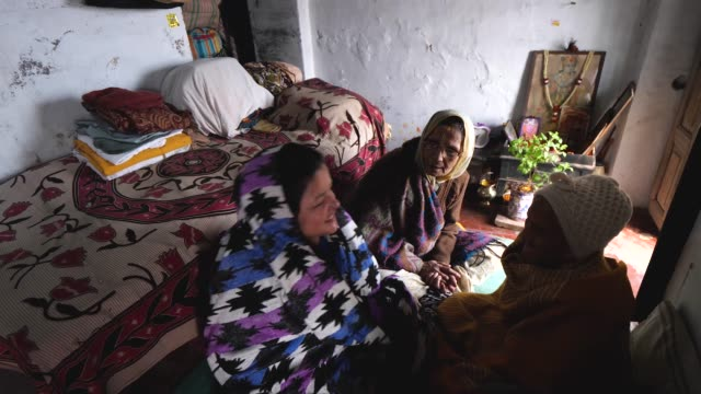 sita devi and meena devi interact with sita's motherinlaw goma devi who estimates she is 90 years old at rak kuti ashram in varanasi india on january... - mother in law stock videos & royalty-free footage