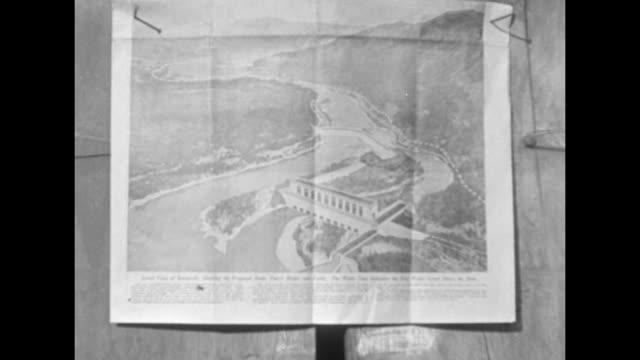 VS site where the Bonneville Dam will be built in the Columbia River in the Columbia River Gorge / VS document with rendering of dam pinned to wall...