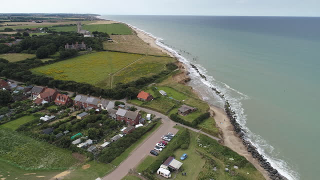 sites of coastal erosion and sea defence barriers, including the villiages of gorleston and happisburgh and bacton gas terminal, in great yarmouth,... - beauty in nature stock videos & royalty-free footage