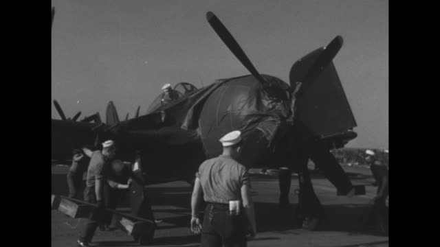 sitkoh bay aircraft carrier delivering f8f bearcats arrives at saigon harbor / thatched canoes / vs bearcats on uss sitkoh bay / sailors rotate... - french army stock videos & royalty-free footage